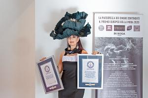 Ольга Иф с сертификатами Книги рекордов Гиннесса ©Фото предоставлено Сусанной Макеровой