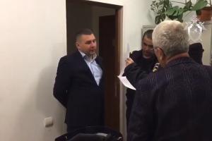 Задержание Алексея Когарлыцкого ©Скриншот видео СК РФ