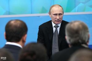 Владимир Путина на встрече с представителями Общественного совета по подготовке и проведению XXII Олимпийских зимних игр (февраль 2014) ©Влад Александров, ЮГА.ру