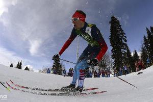 Никита Крюков во время командного спринта на соревнованиях по лыжным гонкам  ©РИА Новости